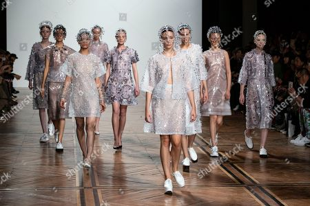 Models present creations from the Spring/Summer 2019 Women's collections by Japanese designer Kunihiko Morinaga for Anrealage during the Paris Fashion Week, in Paris, France, 25 September 2018. The presentation of the Women's collections runs from 24 September to 02 October.