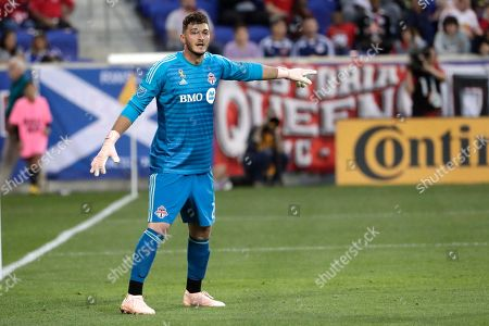 Toronto FC goalkeeper Alex Bono in action against the New York Red Bulls during the second half of a soccer game, in Harrison, N.J