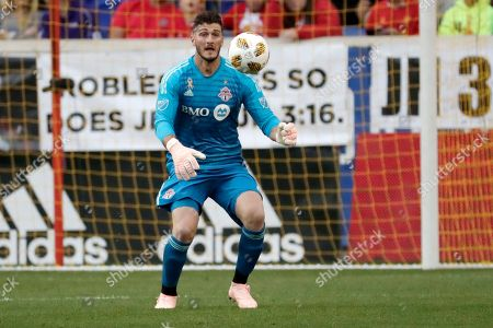 Toronto FC goalkeeper Alex Bono in action against the New York Red Bulls during the first half of a soccer game, in Harrison, N.J