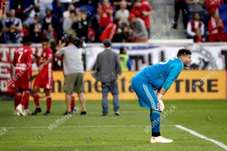 Toronto FC goalkeeper Alex Bono looks on after allowing a goal to New York Red Bulls midfielder Alejandro Romero Gamarra during the second half of a soccer game, in Harrison, N.J