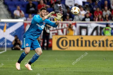 Toronto FC goalkeeper Alex Bono in action against the New York Red Bulls during the second half of a soccer game, in Harrison, N.J. The Red Bulls won 2-0