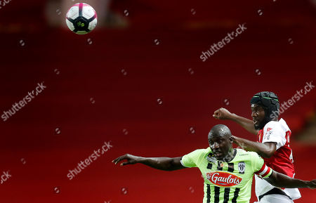 Jean-Eudes Aholou of AS Monaco (R) vies for the ball with Cheikh Ndoye of Angers SCO (L)  during the French Ligue 1 soccer match between AS Monaco and Angers SCO, at Stade Louis II, in Monaco, 25 September 2018.