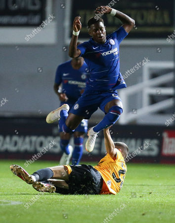 Daishawn Redan of Chelsea U21s jumps out of the tackle from Lewis Collins of Newport County