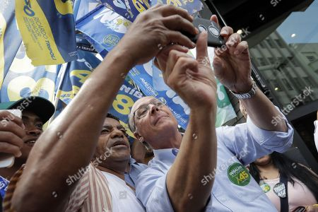 Brazilian Social Democracy Party (PSDB) candidate in Presidential elections Geraldo Alckmin (R) poses for a selfie picture with a supporter during his campaign event, in Sao Paulo, Brazil, 25 September 2018.