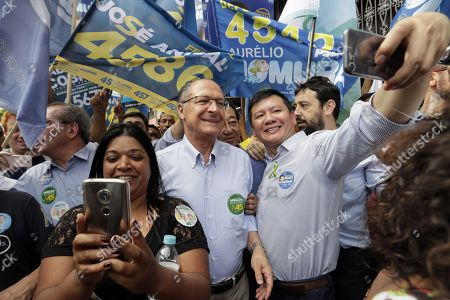 Brazilian Social Democracy Party (PSDB) candidate in Presidential elections Geraldo Alckmin (C) poses for a selfie picture with a supporter during his campaign event, in Sao Paulo, Brazil, 25 September 2018.
