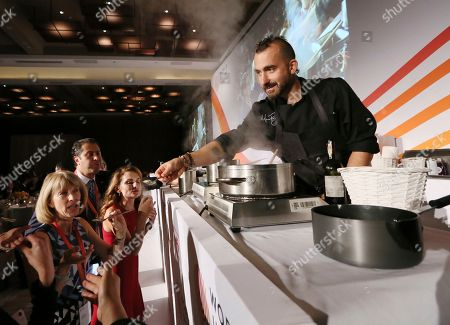 Stock Photo of Celebrity chef Marc Forgione serves up a delicious umami dinner for attendees during the World Umami Forum presented by Ajinomoto Co., Inc., a two-day event to present the facts and correct misperceptions of monosodium glutamate, held at the Conrad Hotel in New York City on September 20-21, 2018