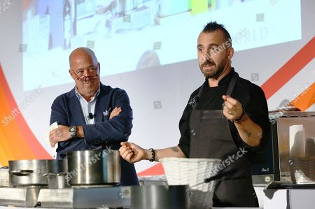 Stock Picture of Celebrity chefs Andrew Zimmern and Marc Forgione serve up an umami dinner for attendees during the World Umami Forum presented by Ajinomoto Co., Inc., a two-day event to present the facts and correct misperceptions of monosodium glutamate, held at the Conrad Hotel in New York City on September 20-21, 2018