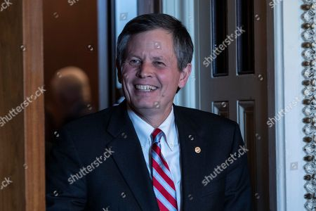 Senator Steve Daines, Republican of Montana, leaves a Republican policy lunch on Capitol Hill in Washington, DC on September 25, 2018.