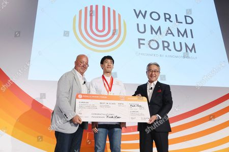 President and CEO of the Ajinomoto Group Takaaki Nishii and celebrity chef Andrew Zimmern announce Nick Lee as the grand prize winner of the cooking competition during the World Umami Forum presented by Ajinomoto Co., Inc., a two-day event to present the facts and correct misperceptions of monosodium glutamate, held at the Conrad Hotel in New York City on September 20-21, 2018