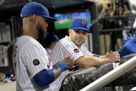 New York Mets' David Wright talks with Jose Reyes, left, during the seventh inning of the team's baseball game against the Atlanta Braves, in New York