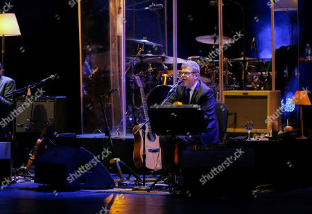 Stock Photo of Argentine composer, producer and musician Gustavo Santaolalla performs at the Teatro Esperanza Iris in Mexico City