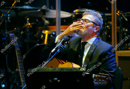 Argentine composer, producer and musician Gustavo Santaolalla blows a kiss to the audience as he performs at the Teatro Esperanza Iris in Mexico City