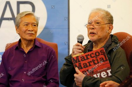 """Rene Saguisag, Satur Ocampo. Former Senator and human rights lawyer Rene Saguisag, holds a copy of a book about the martial law period while relating his ordeal while in detention at a foreign correspondents forum, in Manila, Philippines. The forum was in response to the recent one-on-one interview by Ferdinand """"Bongbong"""" Marcos Jr., the son of the late dictator Ferdinand Marcos, with former Senate President Juan Ponce Enrile, the so-called """"architect of martial law,"""" when Enrile challenged anyone to name one person who got arrested simply because he or she criticized former President Ferdinand Marcos. At left is former Congressman Satur Ocampo"""