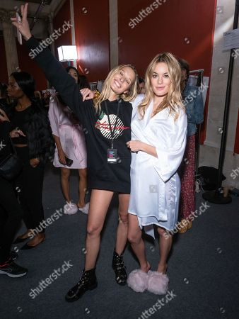 Camille Rowe (L) and Ilona Smet backstage