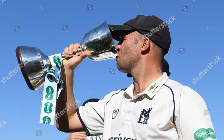 Jonathan Trott drinks form the County Championship Division 2 trophy