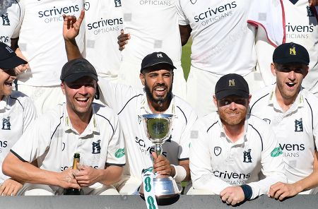 Jonathan Trott, Jeetan Patel and Ian Bell with the trophy