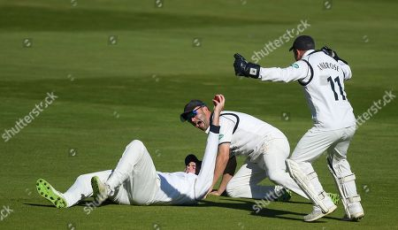 Jonathan Trott and Tim Ambrose celebrate the wicket of Adam Riley as Dom Sibley takes the catch