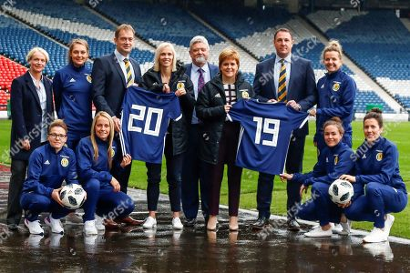 First Minister Nicola Sturgeon (Patron on the Scotland Womens National Team) & Scotland Head Coach Shelley Kerr with Malky Mackay (Scottish FA Performance Director), Ian Maxwell (Scottish FA Chief Executive) and Jim Clydesdale (scottish Football Partnership) along with Scottish National Squad members Joelle Murray (Hibernian FC) Jenna Fife (Hibernian FC) Leanne Crichton (Glasgow City FC) Hayley Lauder (Glasgow City FC) Lee Alexander (Glasgow City FC) & Jo Love (Glasgow City FC) during the press conference for the Scotland Women's team World Cup Funding Announcement held at Hampden Park, Glasgow