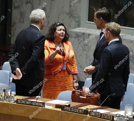 (L-R) Dutch ambassador to the UN Karel J.G. van Oosterom, British amabassador to the UN Karen Pierce, Dutch Prime Minister Mark Rutte and another unidentified diplomat speak before the start of the United Nations Security Council meeting on the sidelines of the General Debate of the General Assembly of the United Nations at United Nations Headquarters in New York, New York, USA, 26 September 2018. The General Debate of the 73rd session began on 25 September 2018.