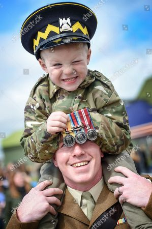 Alfie Warren (5) from Edinburgh getting  to grips with his dad's medals! Corporal Andrew Warren from the Royal Scots Dragoon Guards was receiving his  UN Cyprus Medal.
