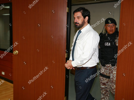 Stock Photo of The American web designer Paul Ceglia (C), arrives for a hearing on his extradition to the United States, in the National Court of Justice of Ecuador, in Quito, Ecuador, 26 September 2018. Others are not identified. Ceglia several years ago demanded half of Facebook's property and is now detained in Ecuador. He faces trial in the USA for alleged fraud and extortion to Facebook founder Mark Zuckerberg, who claimed a part of the company with the argument that he had designed the website and that they had agreed to it in a contract that US authorities considered fraudulent.