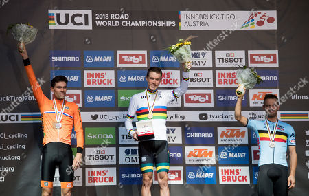 Second placed Tom Dumoulin of the Netherlands (L-R), first placed Rohan Dennis of Australia and third placed Victor Campenaerts of Belgium pose on the podium of the Men's Elite Individual Time Trial at the UCI Road Cycling World Championships, Innsbruck, Austria, 26 September 2018.