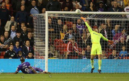 Nottingham Forest's Luke Steele saves from Stoke City's Benik Afobe