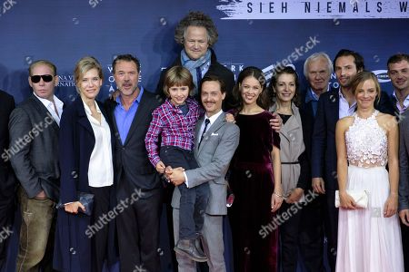 Stock Image of (L-R) Ben Becker, Ina Weisse, Sebastian Koch, Cai Cohrs, filmmaker Florian Henckel von Donnersmarck, Tom Schilling, Paula Beer and Saskia Rosendahl (2-R) pose as they arrive for the German film premiere of 'Werk Ohne Autor' (Never Look Away) in Berlin, Germany, 26 September 2018. The movie by Academy Award-winning German director Florian Henckel von Donnersmarck opens in German cinemas on 03 October 2018.