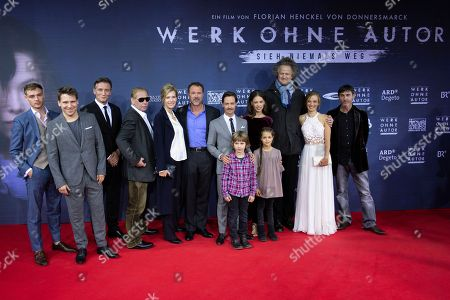 Stock Picture of (Front, L-R) Actors Cai Cohrs and Mina Herfurth, (back, L-R) David Schuetter, Hanno Koffler, Oliver Masucci, Ben Becker, Ina Weisse, Sebastian Koch, Tom Schilling, Paula Beer, filmmaker Florian Henckel von Donnersmarck, Saskia Rosendahl and Mark Zak pose as they arrive for the German film premiere of 'Werk Ohne Autor' (Never Look Away) in Berlin, Germany, 26 September 2018. The movie by Academy Award-winning German director Florian Henckel von Donnersmarck opens in German cinemas on 03 October 2018.