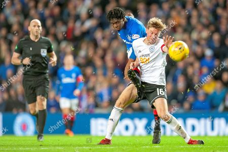 Stock Picture of Steve Bell (#16) of Ayr United FC attemts to block a shot by Oviemuno Ejaria (#10) of Rangers FC during the Betfred Cup match between Rangers and Ayr United at Ibrox, Glasgow
