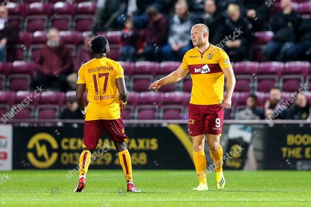 Curtis Main (#9) of Motherwell celebrates Motherwell's first goal (0-1) with Gael Bigirimana (#17) of Motherwell during the Betfred Cup match between Heart of Midlothian and Motherwell at Tynecastle Stadium, Gorgie