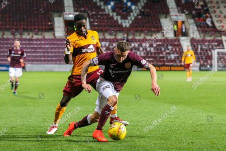 Callumn Morrison (#38) of Heart of Midlothian accelerates away from the challenge of Gael Bigirimana (#17) of Motherwell during the Betfred Cup match between Heart of Midlothian and Motherwell at Tynecastle Stadium, Gorgie