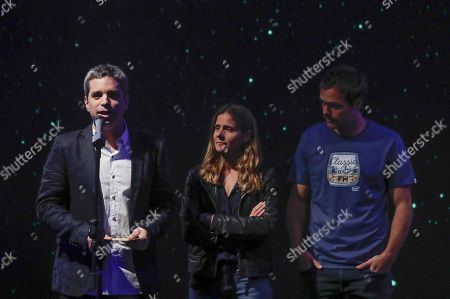 Argentinian actor Peter Lanzani (R) with 'Kys Films' producers Matias Mosteirin (L) and Leticia Cristi (C) attend a ceremony to announce the film that will represent Argentina in the Goya Awards and the Oscars, in Buenos Aires, Argentina, 26 September 2018. The film 'El Angel' by director Luis Ortega will represent Argentina in Acadamy Awards and in the Spanish Goya Awards.
