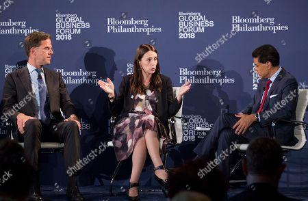 New Zealand Prime Minister Jacinda Ardern, center, speaks at the Bloomberg Global Business Forum, in New York. Listening are Mark Rutte, left, Prime Minister of the Netherlands and CNN's Fareed Zakaria