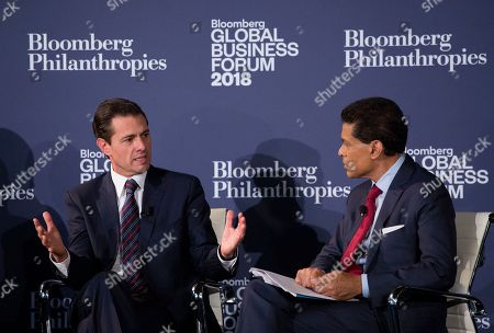 Enrique Peña Nieto, left, President of Mexico, speaks with CNN's Fareed Zakaria at the Bloomberg Global Business Forum, in New York