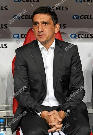 Stuttgart coach Tayfun Korkut waits prior the German first division Bundesliga soccer match between RB Leipzig and VFB Stuttgart in Leipzig, Germany