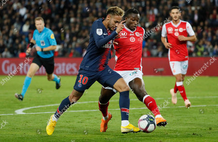 Neymar (L) of Paris Saint Germain and Nclomande Ghislain Konan (R) of Reims in action  during the French Ligue 1 soccer match between Paris Saint Germain and Reims, in Paris, France 26 September 2018.