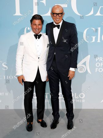 Italian CEO of Gucci Marco Bizzarri (R) and Giorgio Veroni (L) attend the 2nd Monte-Carlo Gala for the Global Ocean 2018 in Monaco, 26 September 2018. The Monte Carlo Gala for the Global Ocean, hosted by the Prince Albert II of Monaco Foundation, is a fundraising auction, to support the Foundation's marine conservation initiatives.