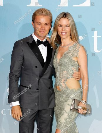 German former Formula One driver Nico Rosberg (L) and wife Vivian Sibold (R) attend the 2nd Monte-Carlo Gala for the Global Ocean 2018 in Monaco, 26 September 2018. The Monte Carlo Gala for the Global Ocean, hosted by the Prince Albert II of Monaco Foundation, is a fundraising auction, to support the Foundation?'s marine conservation initiatives.