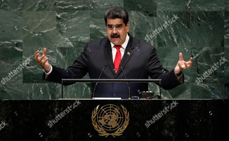 Stock Photo of President of Venezuela Nicolas Maduro Moros speaks during the General Debate of the General Assembly of the United Nations at United Nations Headquarters in New York, New York, USA, 26 September 2018. The General Debate of the 73rd session will run from 25 September 2018 to 01 October 2018.