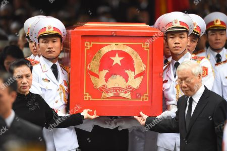 Chairwoman of the National Assembly of Vietnam Nguyen Thi Kim Ngan (L), General Secretary of the Communist Party of Vietnam Nguyen Phu Trong (R) along with soldiers carry the coffin of late President Tran Dai Quang to an artillery cart at the National Funeral House in Hanoi, Vietnam, 27 September 2018. President Tran Dai Quang died on 21 September 2018 at the age of 61.