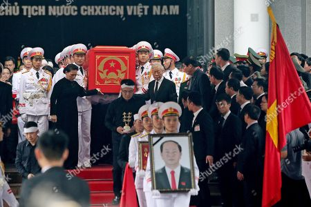 Chairwoman of the National Assembly of Vietnam Nguyen Thi Kim Ngan (C-L), General Secretary of the Communist Party of Vietnam Nguyen Phu Trong (C-R) along with soldiers carry the coffin of late President Tran Dai Quang to an artillery cart at the National Funeral House in Hanoi, Vietnam, 27 September 2018. President Tran Dai Quang died on 21 September 2018 at the age of 61.