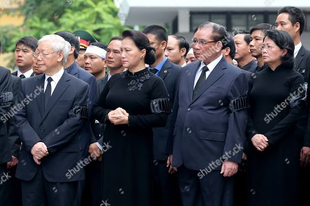 (L-R) General secretary of the Communist Party of Vietnam Nguyen Phu Trong, Chairwoman of the National Assembly of Vietnam Nguyen Thi Kim Ngan, Former General secretary of the Communist Party of Vietnam Nong Duc Manh, Vietnam's acting President Dang Thi Ngoc Thinh attend the National Funeral of Vietnam's President Tran Dai Quang, at the National Funeral House in Hanoi, Vietnam, 27 September 2018. President Tran Dai Quang died on 21 September 2018 at the age of 61.