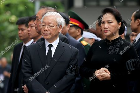 General secretary of the Communist Party of Vietnam Nguyen Phu Trong (L) and Chairwoman of the National Assembly of Vietnam Nguyen Thi Kim Ngan (R) look on during the National Funeral of Vietnam's President Tran Dai Quang, at the National Funeral House in Hanoi, Vietnam, 27 September 2018. President Tran Dai Quang died on 21 September 2018 at the age of 61.