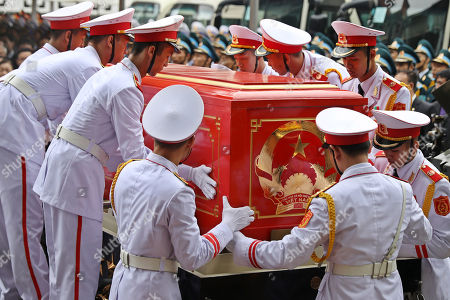 Soldiers place the coffin of Vietnam's late President Tran Dai Quang on to an artillery cart at the National Funeral House in Hanoi, Vietnam, 27 September 2018. President Tran Dai Quang died on 21 September 2018 at the age of 61.