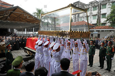 Soldiers lift the glass cover up to put on the coffin of Vietnam's late President Tran Dai Quang, which will be transported on an artillery cart, at the National Funeral House in Hanoi, Vietnam, 27 September 2018. President Tran Dai Quang died on 21 September 2018 at the age of 61.