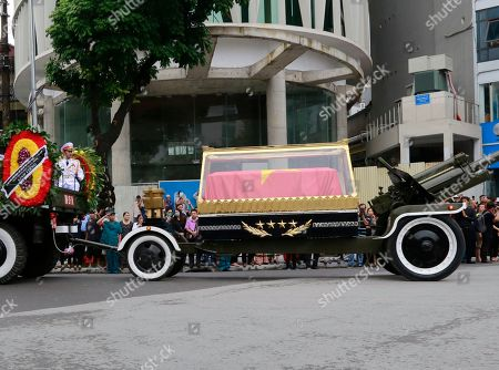 National flag-draped coffin of late President Tran Dai Quang on truck-drawn artillery carriage passes by in Hanoi, Vietnam, . Thousands of people line streets in capital Hanoi to pay their last respects to the late president who died last week of viral illness