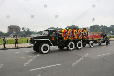 The vehicle pulling the coffin of the Vietnam's late President Tran Dai Quang passes the Ho Chi Minh Mausoleum on a street in Hanoi, Vietnam, 27 September 2018. President Tran Dai Quang died on 21 September 2018 at the age of 61.