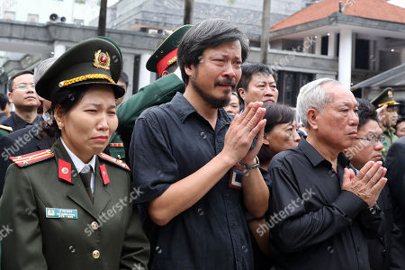 Stock Picture of People react during the national funeral of Vietnam's late President Tran Dai Quang at the national funeral House in Hanoi, Vietnam, 27 September 2018. President Tran Dai Quang died on 21 September 2018 at the age of 61.
