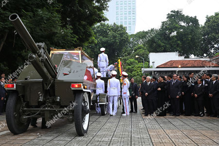 Vietnam's officials and delegations stand next to the vehicle pulling the coffin of the Vietnam's late President Tran Dai Quang during his funeral at the national funeral House in Hanoi, Vietnam, 27 September 2018. President Tran Dai Quang died on 21 September 2018 at the age of 61.